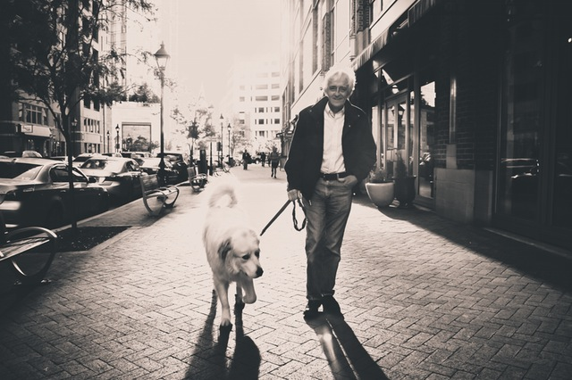 old man with a dog walking