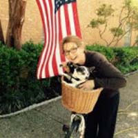 owner holding a dog in a bike