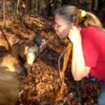 woman staring at a dog